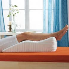 Coussin relève-jambes ergonomique