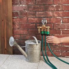 Raccord de robinet à quatre sorties