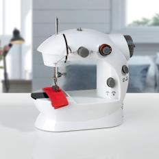 Mini machine à coudre électrique