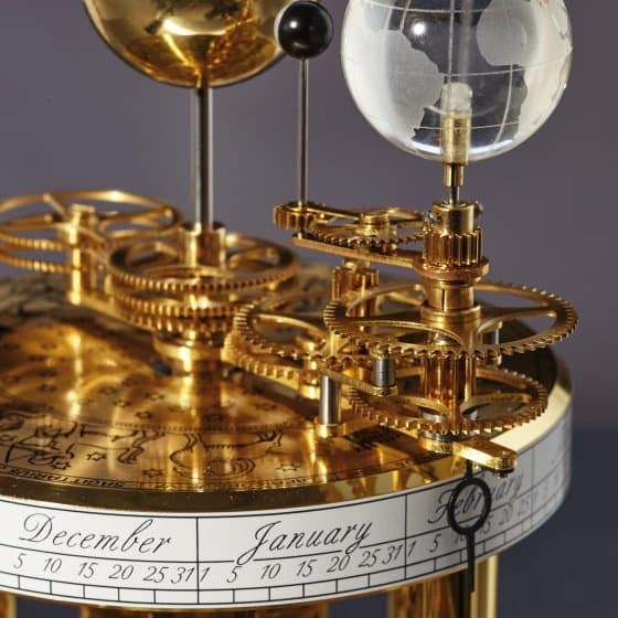 Pendule astrolabe laiton/acajou